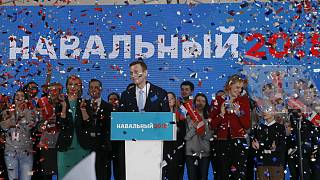 Alexei Navalny attends a meeting to uphold his bid for presidential candida