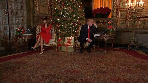 Melania and Donald Trump speak to children
