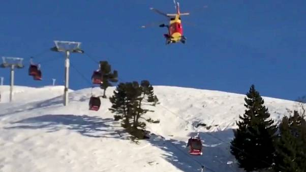 Skiers trapped in broken down gondolas in the French Alps are dramatically rescued