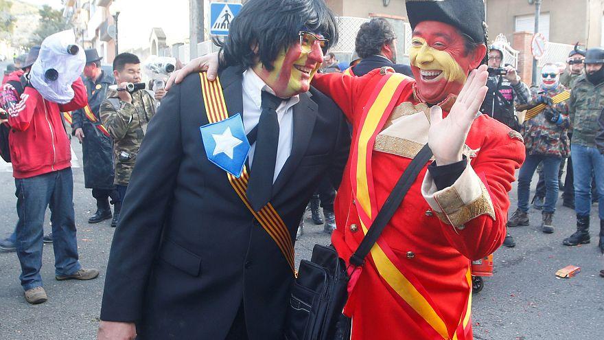 A reveller masked as former Catalonian President Carles Puigdemont