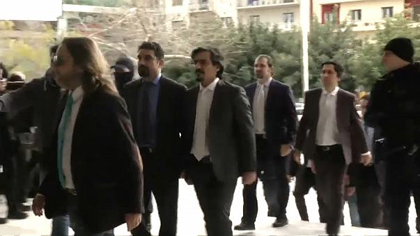 Archive footage of the eight soldiers arriving in court