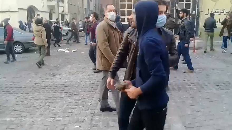 Protesters threw stones in clashes with riot police