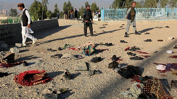 Belongings of blast victims lie on the ground on the outskirts of Jalalabad