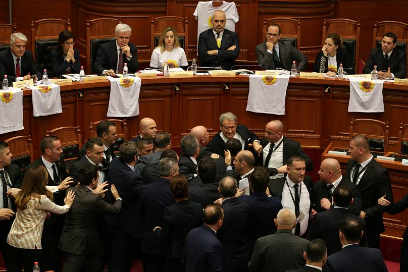 Deputies of the Democratic party forcefully occupy the parliamentary podium during a parliamentary session for the election of the new prosecutor.