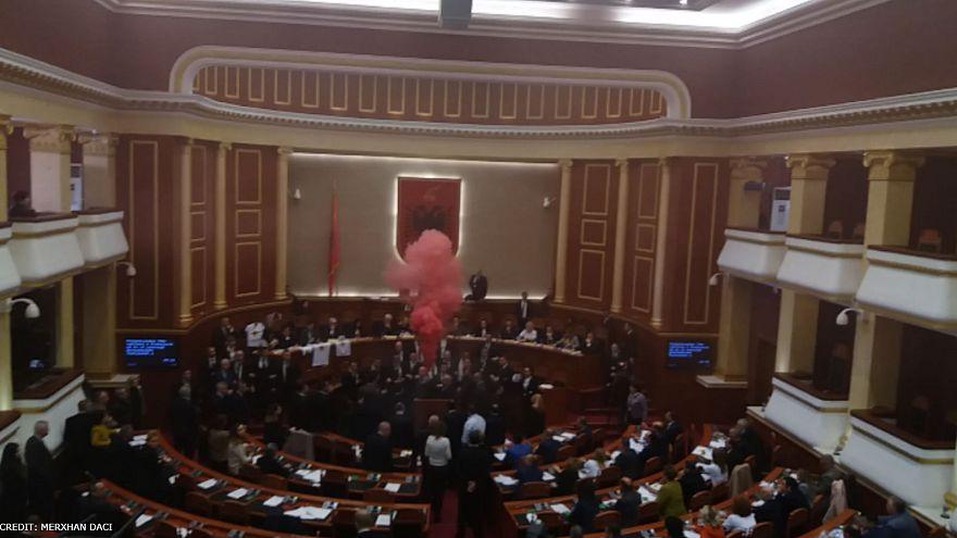A smoke bomb erupts in Albania's parliament