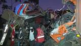 Rescue workers comb through the wreckage of a crashed bus in Kenya