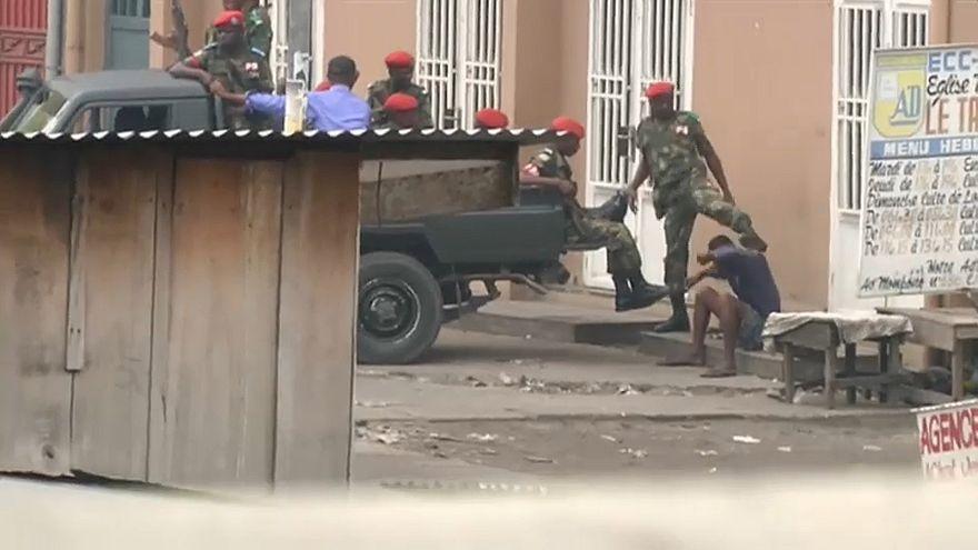 police kick protester
