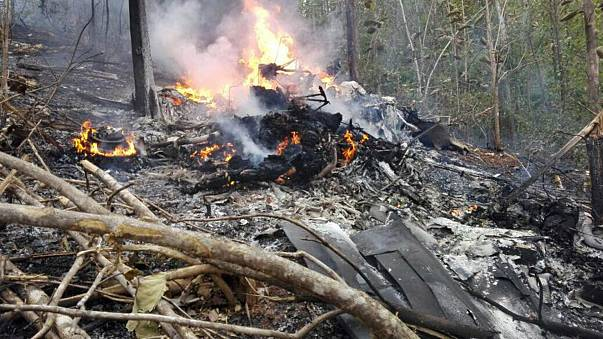 Smoke and fire seen at the site where a plane crashed