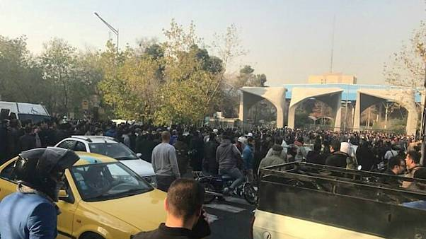 People protest near the university of Tehran