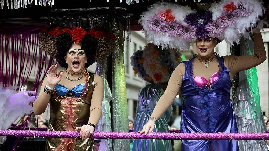 Performers wave to the crowd during the New Year's Day parade in London