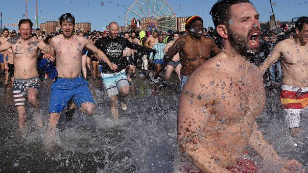 Thousands brave icy waters for New Year's plunge