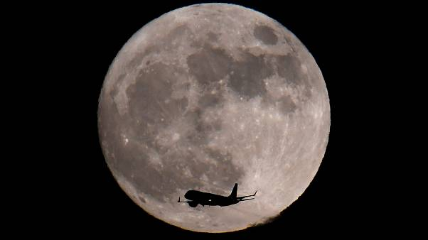 Rare supermoon delights stargazers on New Year's day