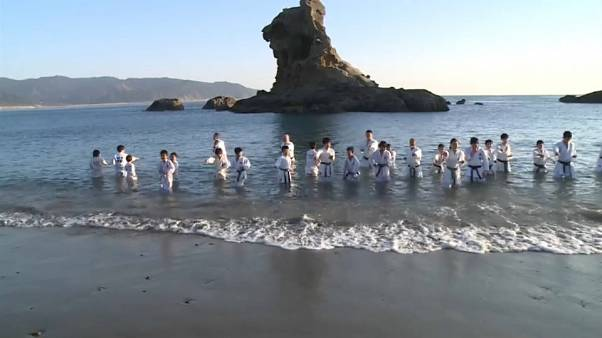 Chilly swim for karate kids in Japan