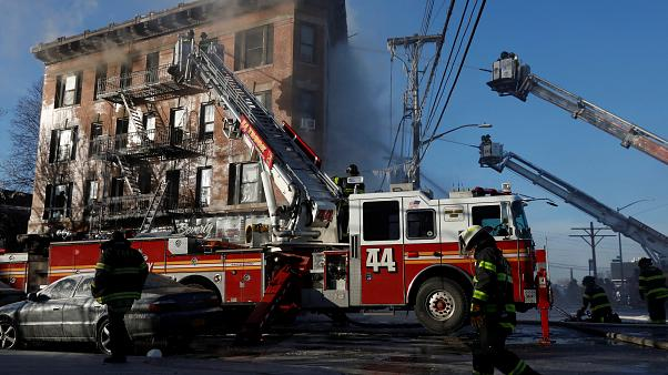 FDNY firemen work at an apartment building in the Bronx, New York, U.S.