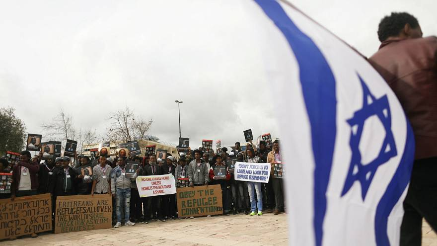 African migrants hold placard  protest outside Israel Supreme Court