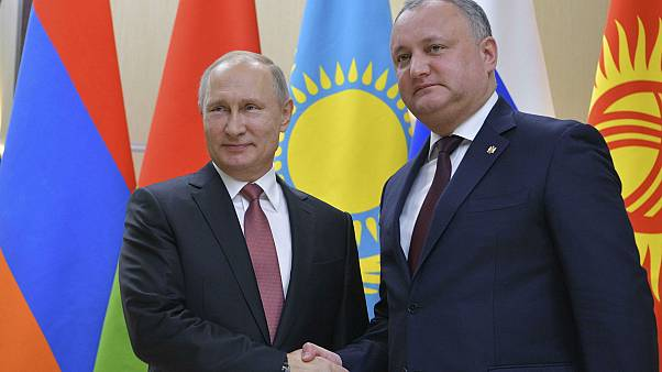 Moldovan President Igor Dodon shakes hands with his Russian counterpart