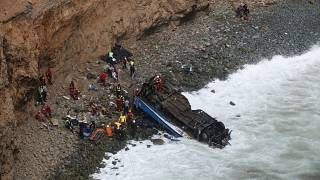 At least 48 are killed after a bus plunges off a cliff on a highway known as 'Devil's Curve' in Peru