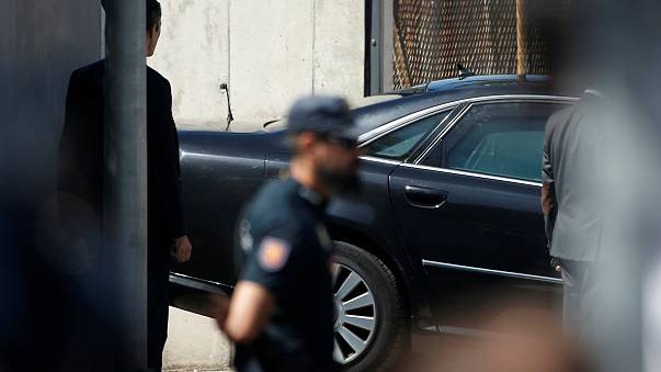The car carrying Spain's PM Rajoy leaves the courthouse garage