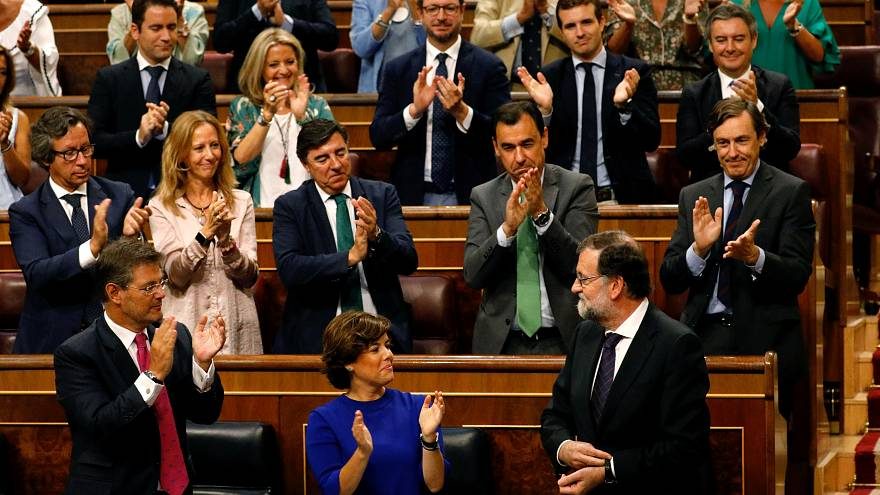 Spanish Prime Minister Mariano Rajoy receives applause from his party