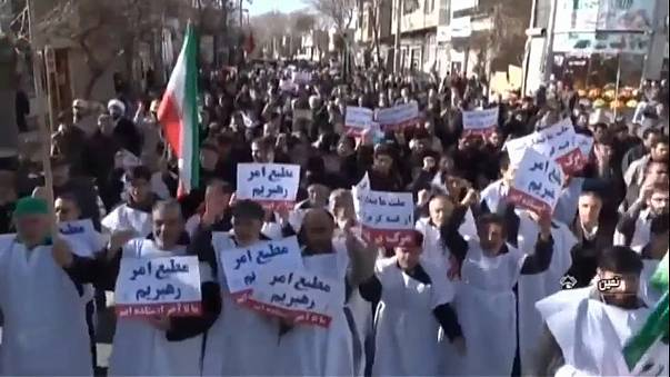 Groups march in support of Iran's regime
