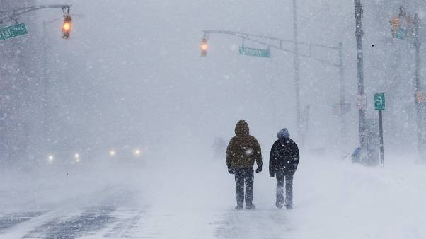 People struggle against wind and snow at the Jersey shore in Long Branch NJ