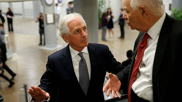 Senator Bob Corker speaks with Senator Ben Cardin