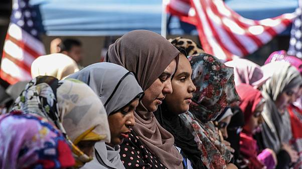 Women participate in a group prayer in New York City