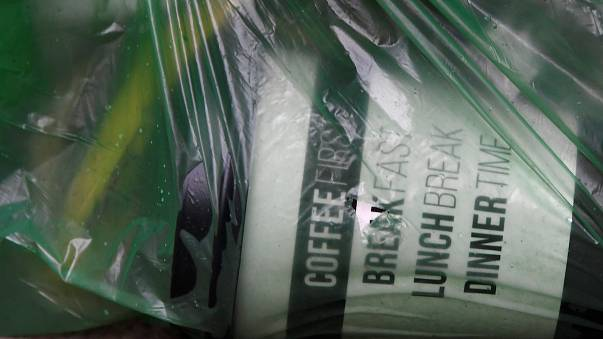 A disposable coffee cup is seen in a refuse bag in London, UK