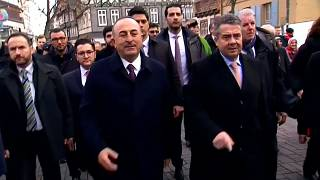 Turkish and German foreign ministers in talks to ease tensions