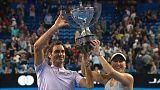 Roger Federer and Belinda Bencic hold aloft the Hopman Cup for Switzerland