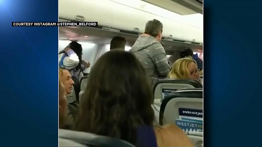 Passengers scramble to emergency exits