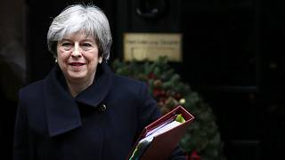 Theresa May leaves 10 Downing Street in London, Dec. 13, 2017