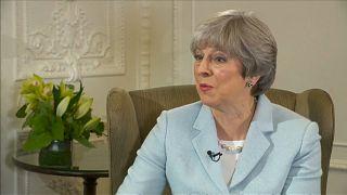 La Premier May difende Trump