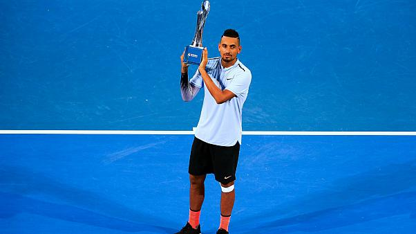 Nick Kyrgios holds aloft Brisbane International title