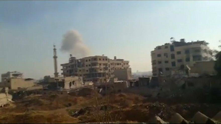 Syrian troops break rebel siege near Damascus
