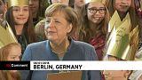 Merkel canta villancicos junto a jóvenes católicos