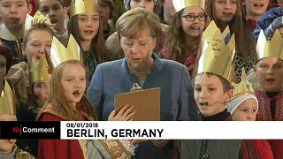 Меркель приняла участие в песнопениях по случаю Богоявления