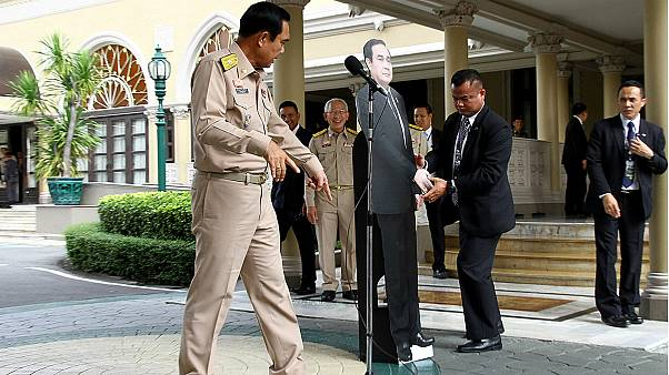 Thai PM leaves cardboard cutout of himself to answer journalists' questions