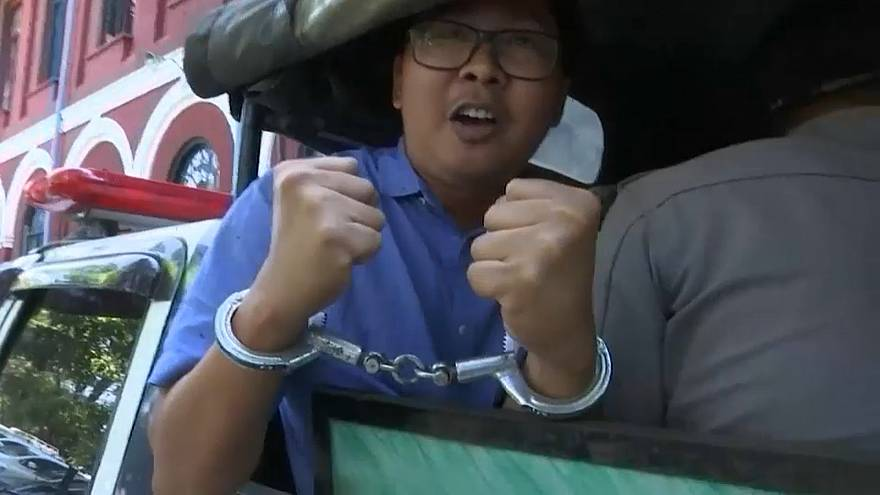 Reuters journalist Wa Lone on the way to court in handcuffs,