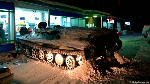 Russian man tries to beat closing time with tank