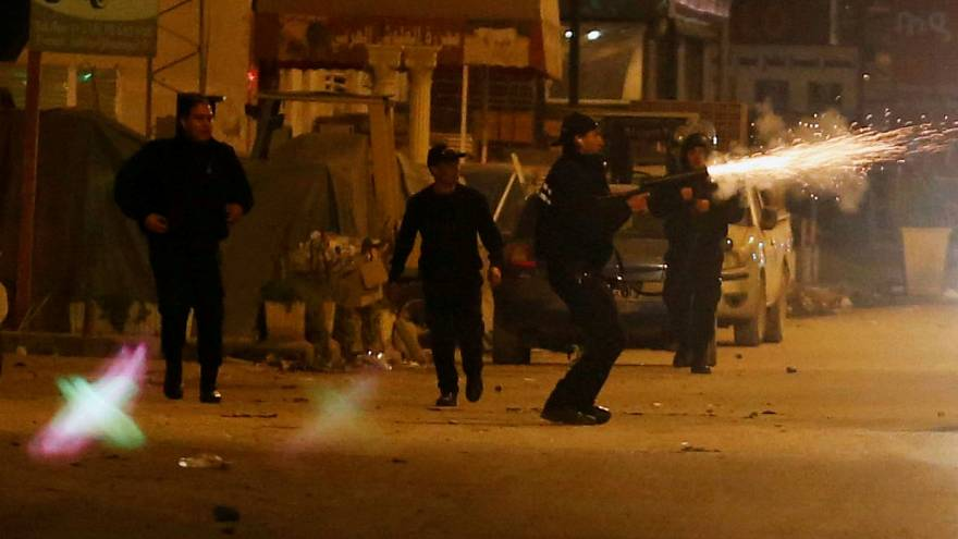 Police officers fire tear gas