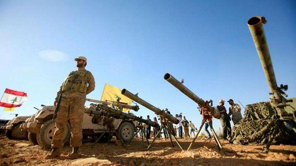 خلال استعراض أفراد من حزب الله لأسلحة ومدرعات