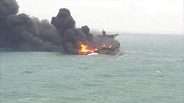 Families' anguish as Iran tanker burns