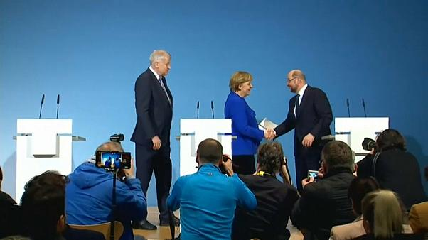 Merkel and Schulz shake hands
