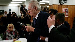 Czech President Milos Zeman arrives to cast a vote befor femen attack