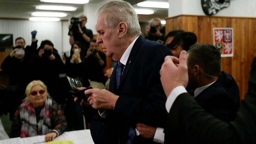 Czech President Milos Zeman arrives to cast a vote befor femen attack