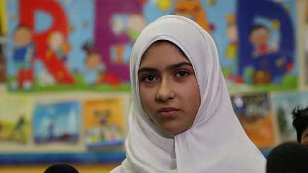 Khawlah Noman speaks to reporters at Pauline Johnson Junior Public School