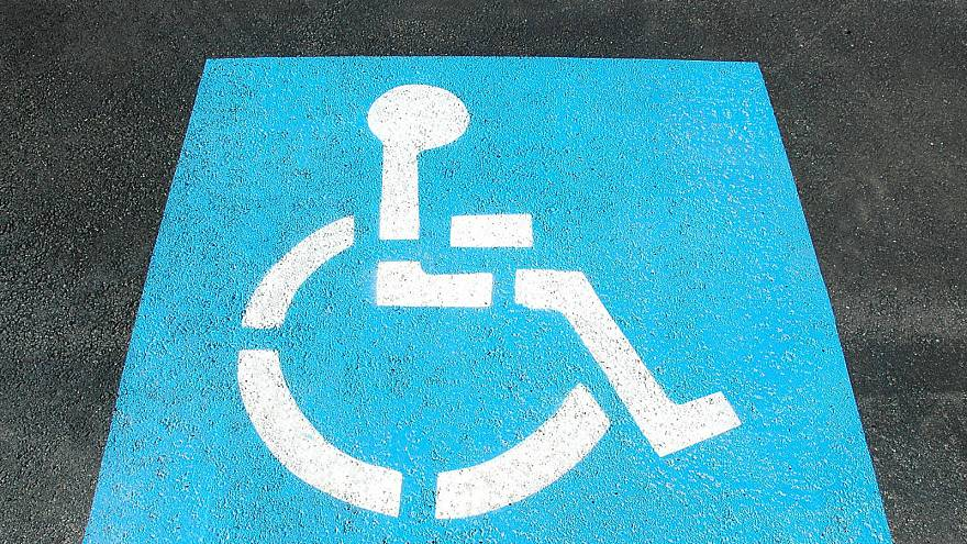 Texas city trains volunteers to catch drivers who park in disabled spaces