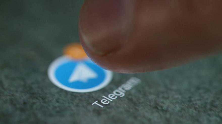The Telegram app logo is seen on a smartphone in this picture illustration