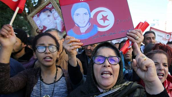 People attend demonstrations on the seventh anniversary of revolution